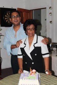 Mr. Beepat with his mother celebrating her birthday
